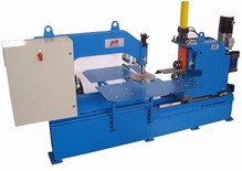 Machine to Cut discs with loading and unloading by robot.